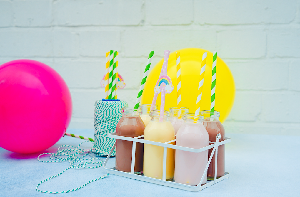 Cups with drinks and straws