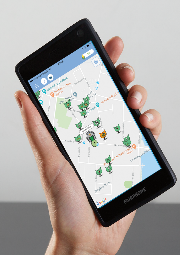 Hand holding smart phone with One Zest map